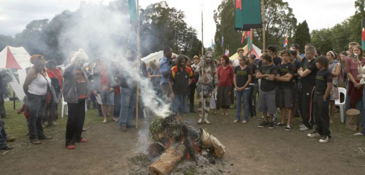 Crowd at the Aboriginal Tent Embassy gathered around the smoking ceremony to mark the Apology to the Stolen Generations