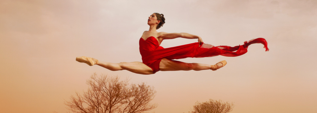 dancer leaping over trees