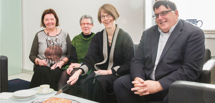 Photo of Director-General Anne-Marie Schwirtlich AM cutting cake with CMG members