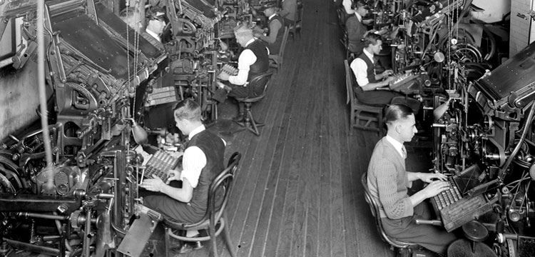 Men working on the linotype machines in the SMH building