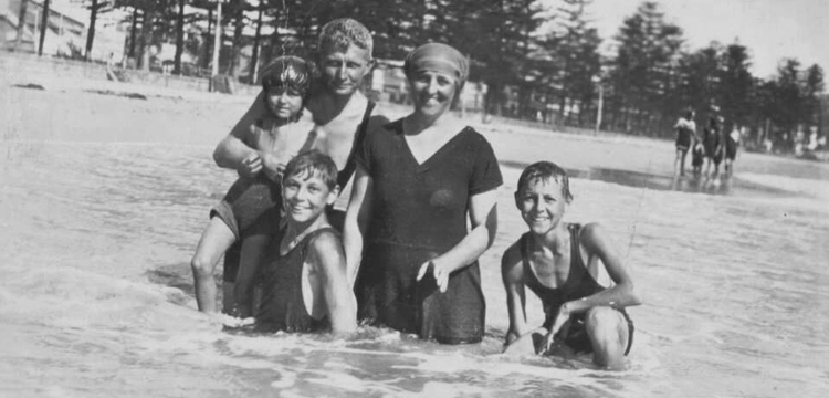 A family in the water at Manly beach