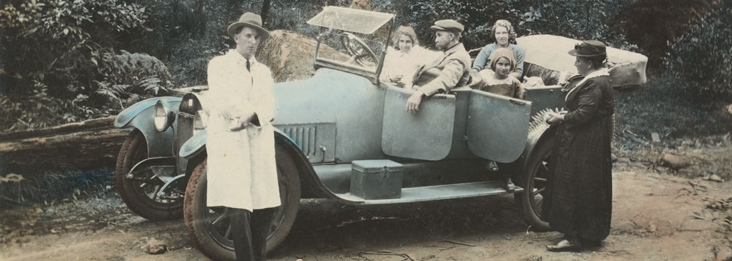 Historic photo of a family in their car