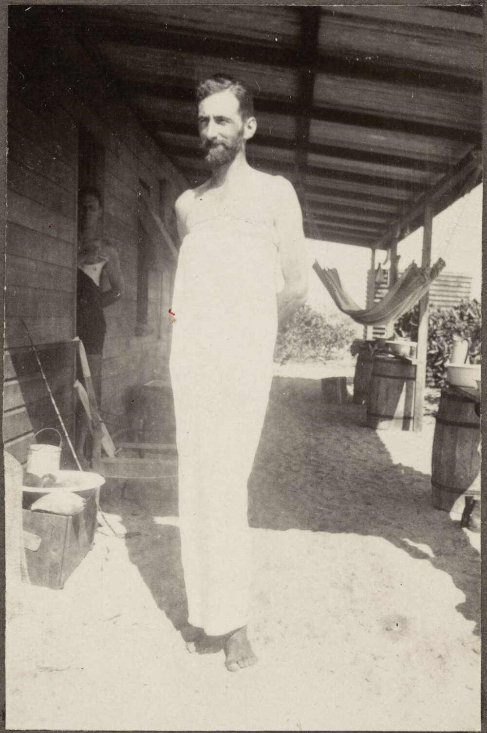 Unknown photographer, Geoffrey Tandy solves the heat problem with the aid of a bed sheet, 1928, gelatin silver photograph, in Presentation album to Mattie Yonge by the Australian Museum team who joined the Great Barrier Reef Expedition, Low Islands, Qu
