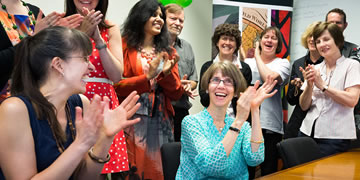 Staff at the National Library of Australia applaud as the first ebook arrives under the new legal deposit legislation.