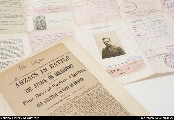 photograph of newspaper clippings and war papers