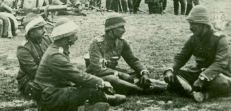 soldiers in uniform seated on ground