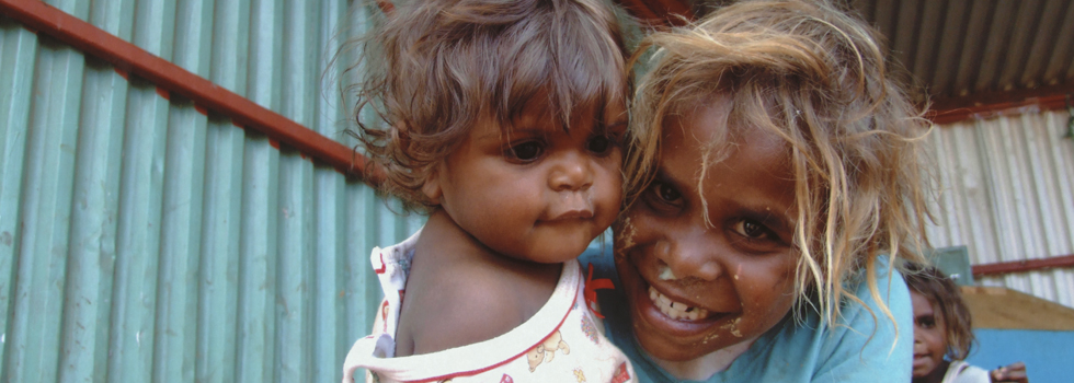 Young Indigenous cousins smiling