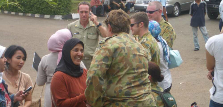 Indonesian women greeting Australian Defence Force personnel during the relief operation in Aceh, Indonesia after the tsunami