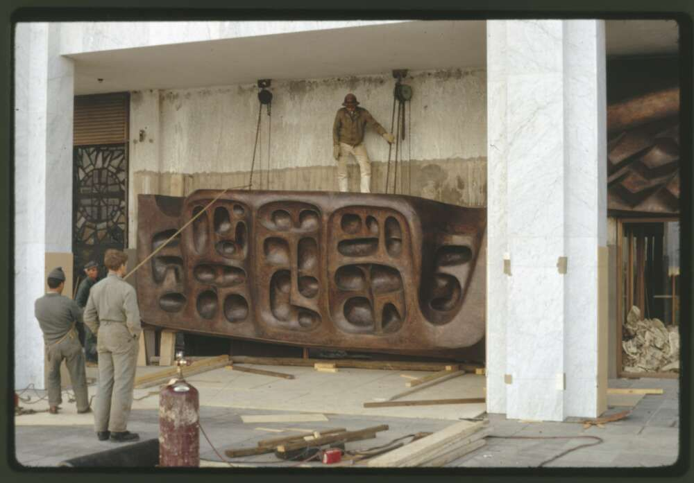 installing_the_tom_bass_lintel_sculpture_over_the_main_entrance._may_1969_nla.obj-148346938-1.jpg