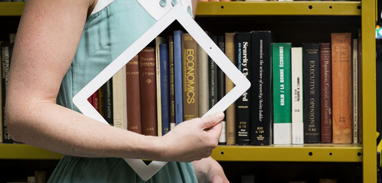 torso carrying ipad with image of books