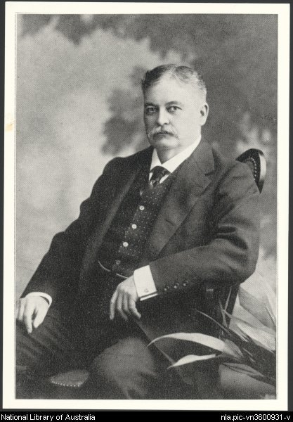 Portrait of J.C. Williamson sitting on a chair