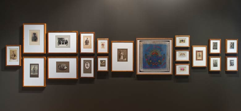 Exhibition gallery wall with images mounted in frames
