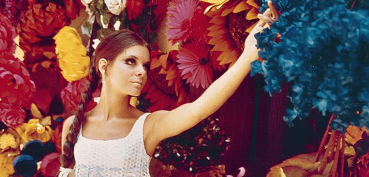 Model in Lacy Dress in Front of Flowers