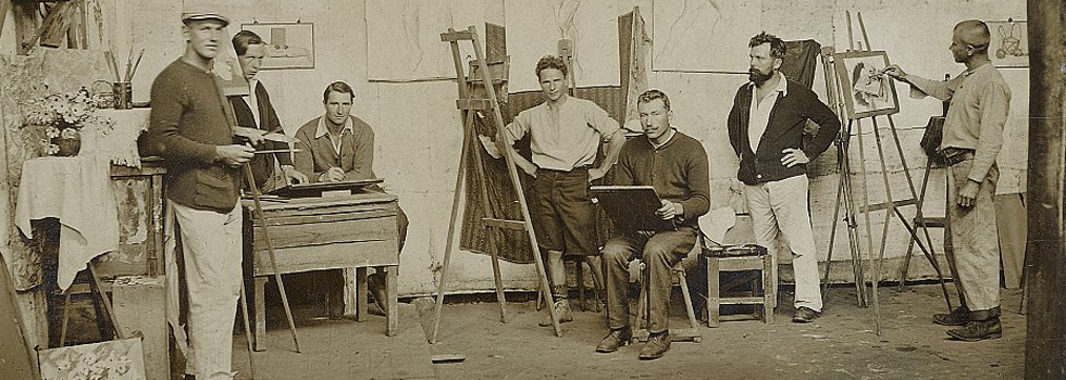 Seven men painting in art studio
