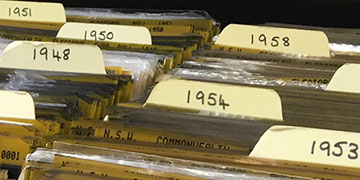 A drawer of microfiche filed by date