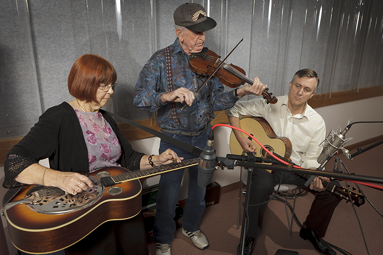 Les and June Bruton playing musical instruments with Kevin Bradley during a recording session at the National Library of Australia