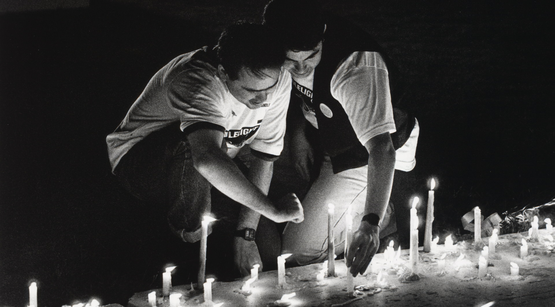 Two men with candles
