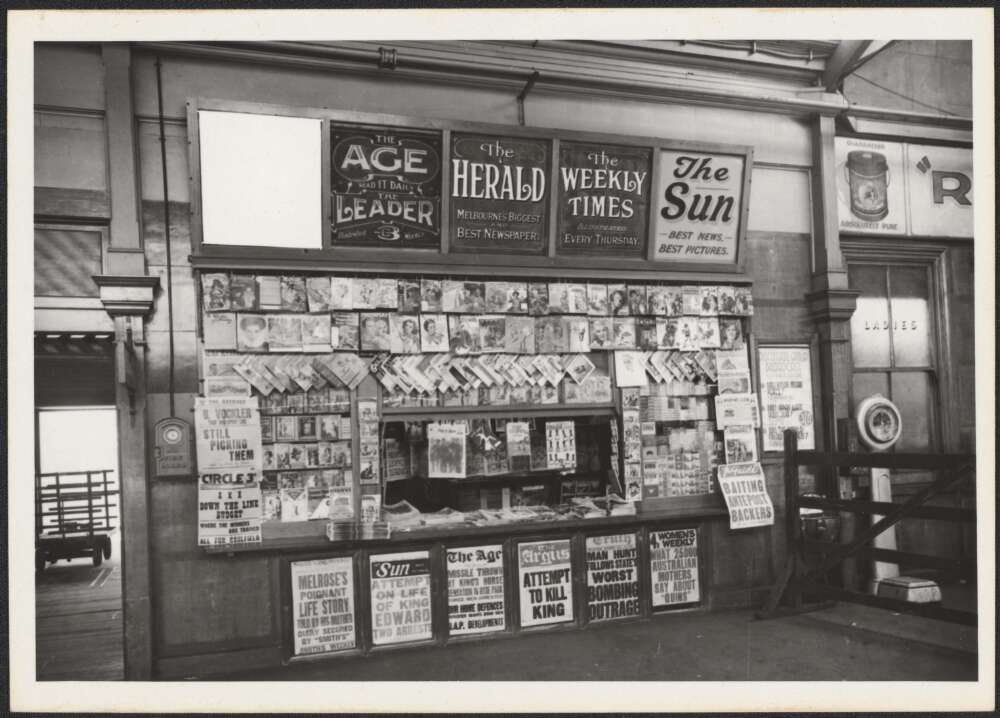 Newspaper stand in a railway station headlining attempt to kill King, Victoria, 1936