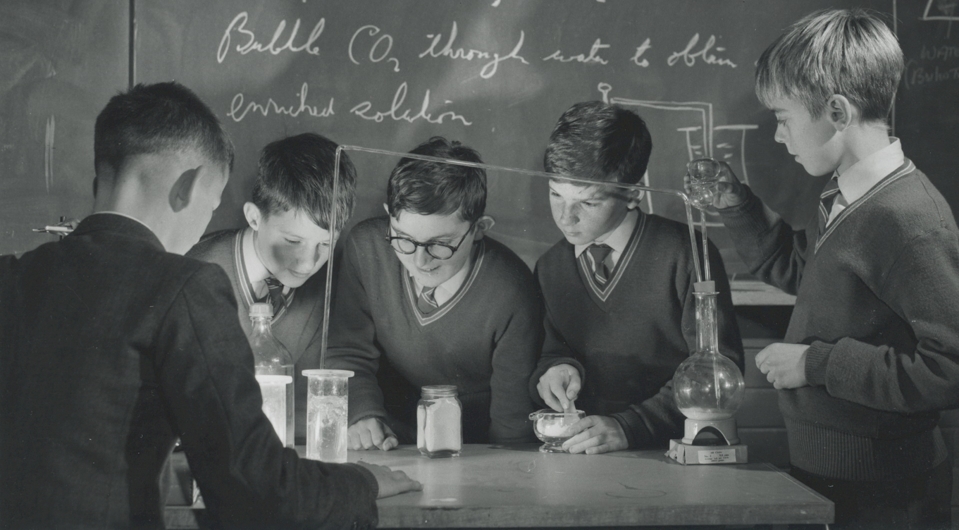 A group of students in a school science laboratory