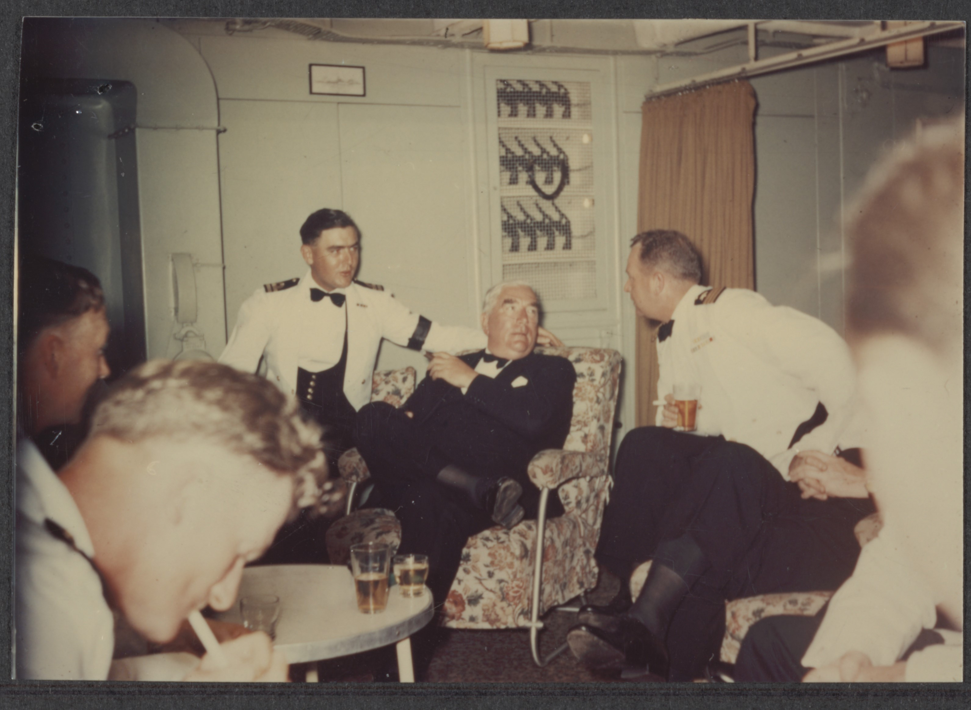 Sir Robert Menzies socialising with crew on a ship
