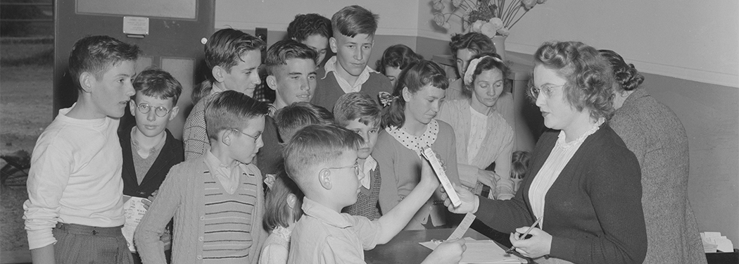 A group of children and librarian at Waratah branch library, Newcastle, New South Wales, 13 September 1948