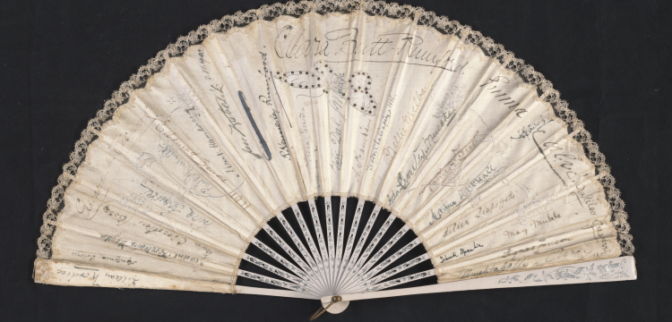 An open commemorative fan with signatures.