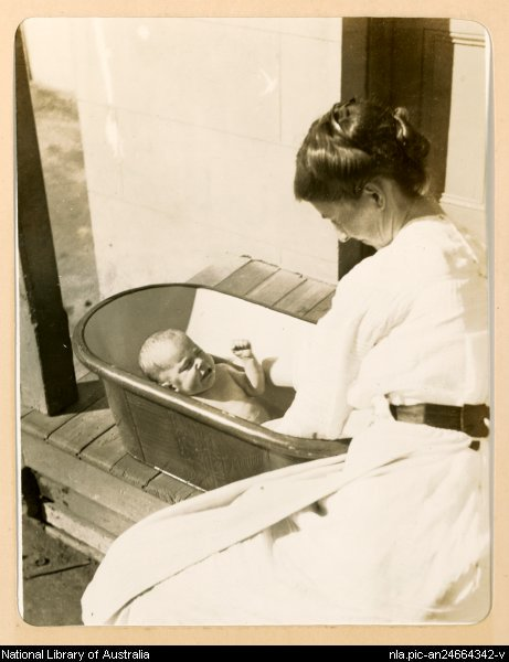 [Woman bathing a young baby, early 1900s, 1]
