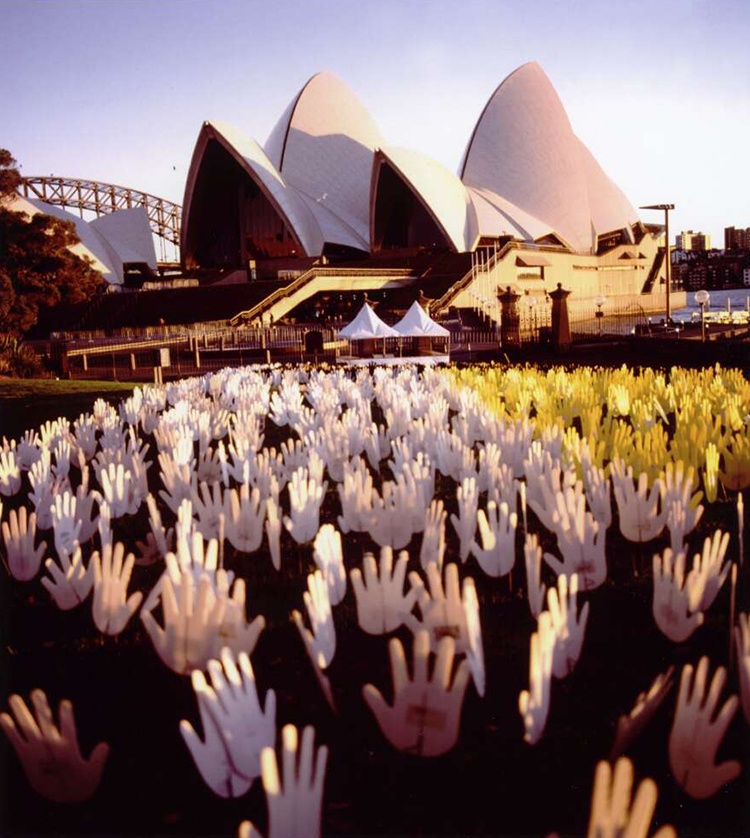 Sea of Hands with the Sydney Opera House in the Background During Corroboree