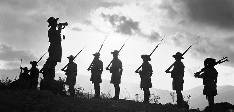 Silhouette of a bugler and soldiers