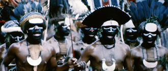 A group of men performing a traditional Papua New Guinea dance
