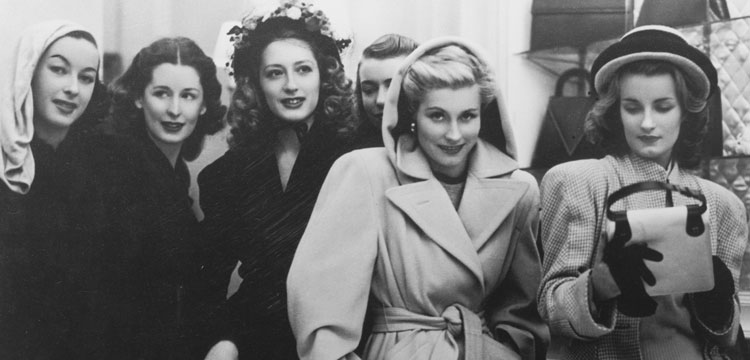 Group of French fashion models in winter coats at a handbag shop in Melbourne, 1946