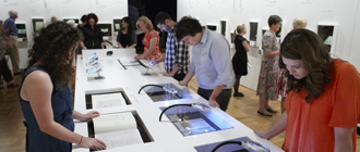 People viewing an exhibition