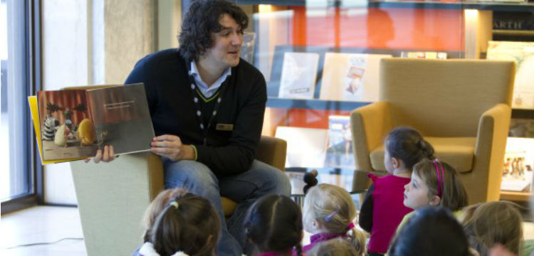 Image of reader and children at a storytime session