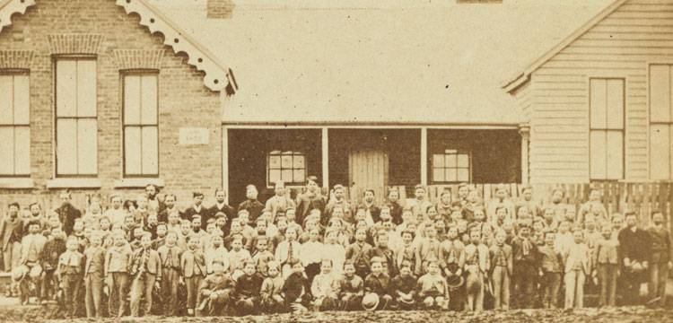Image of School boys and teachers outside brick and weatherboard Hill End Public School
