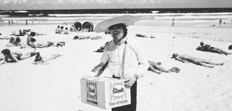 Chinese student holding a Streets Ice cream box on Bondi Beach