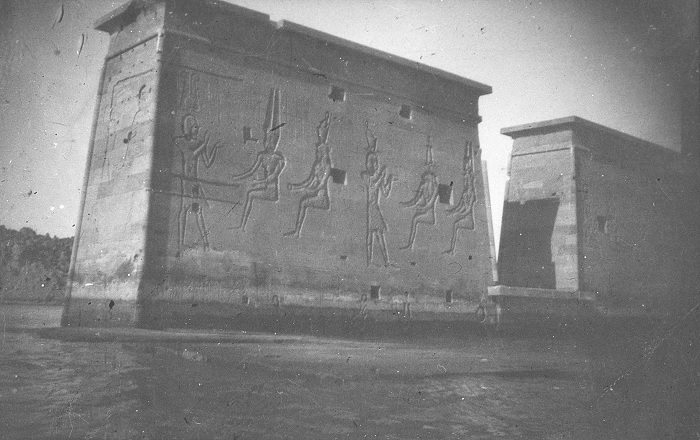 A grainy, black and white photograph of the partly submerged Temple of Isis in Egypt.