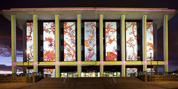 National Library building lit up with artistic projections