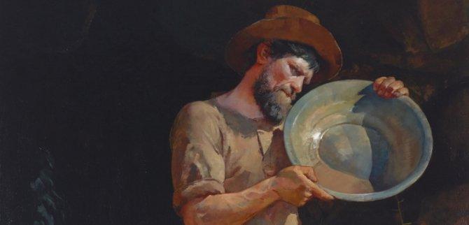 A prospector holding a pan.