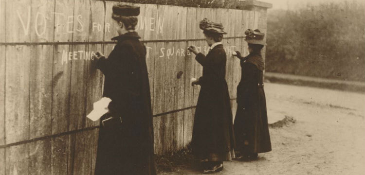 Women write pro-suffragette graffiti