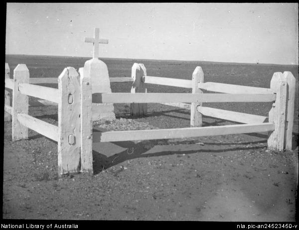 Unidentified grave surrounded by a white wooden fence